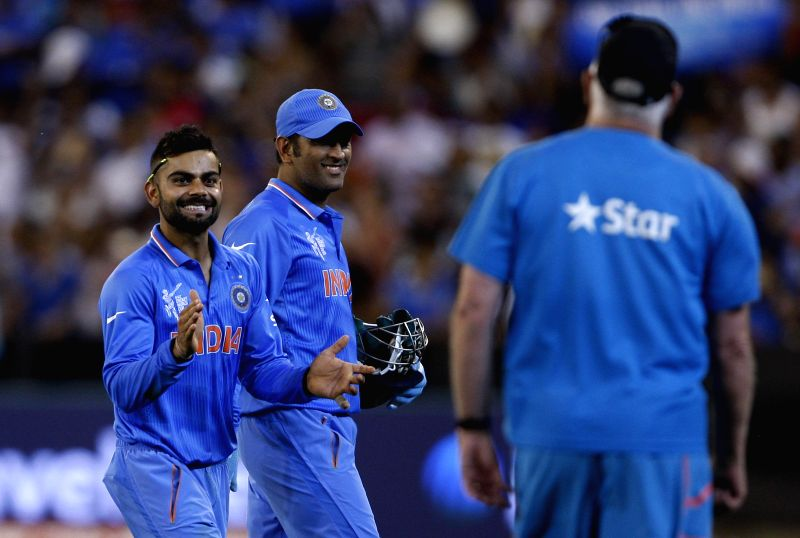 Indian cricketers Virat Kohli and M S Dhoni celebrate after winning an ICC World Cup 2015 match between India and South Africa at Melbourne Cricket Ground, Australia on Feb 22, 2015. - Virat Kohli