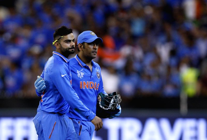 Indian cricketers Virat Kohli and M S Dhoni during an ICC World Cup 2015 match between India and South Africa at Melbourne Cricket Ground, Australia on Feb 22, 2015. - Virat Kohli