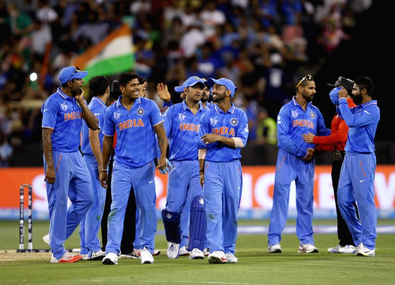 Indian players celebrate after winning an ICC World Cup 2015 match between India and South Africa at Melbourne Cricket Ground, Australia on Feb 22, 2015.
