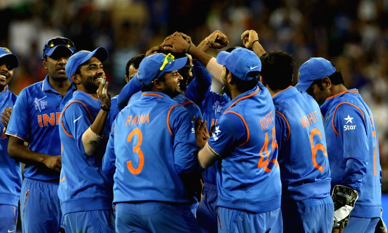 Indian players celebrate fall of a wicket during the ICC World Cup - 2015 quarter final match between India and Bangladesh at Melbourne Cricket Ground in Australia on March 19, 2015.