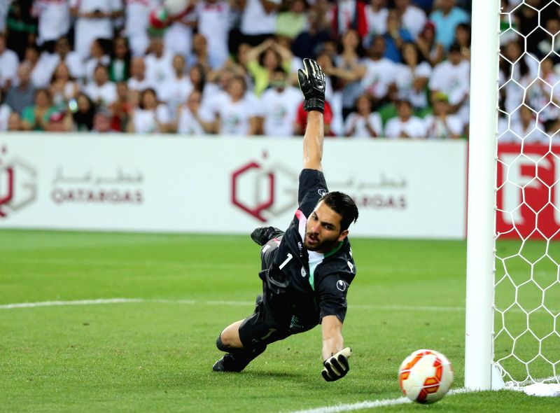 Ali Reza Haghighi of Iran saves the ball during a Group C match against Bahrain at the AFC Asian Cup in Melbourne, Australia, Jan. 11, 2015. Iran won 2-0. ...