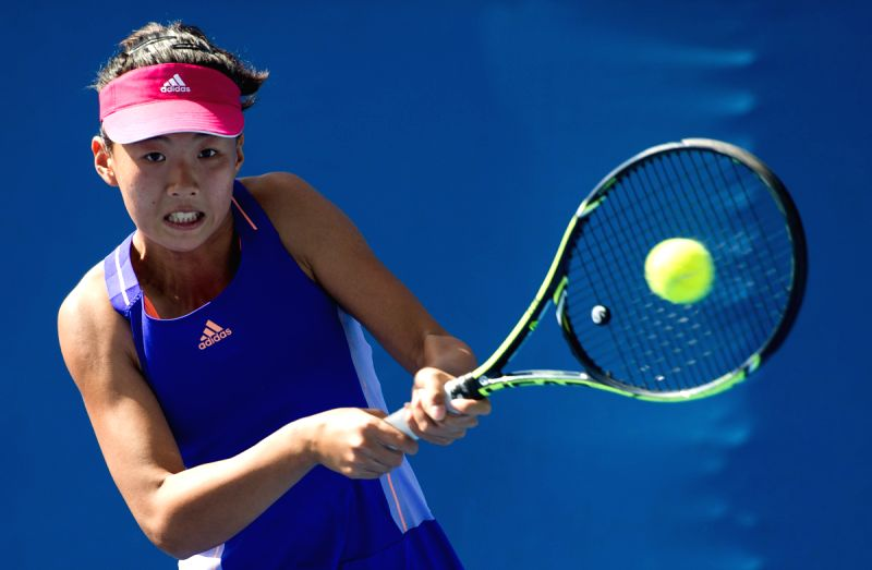 Liu Fangzhou of China returns the ball during the women's singles qualifying final round match against Petra Martic of Croatia ahead of 2015 Australian Open ...