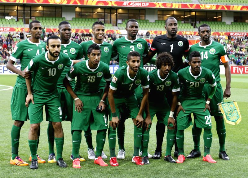 Players of Saudi Arabia line up for a team photo before a group B match between Uzbekistan and Saudi Arabia of the AFC Asian Cup in Melbourne, Australia, Jan. ...