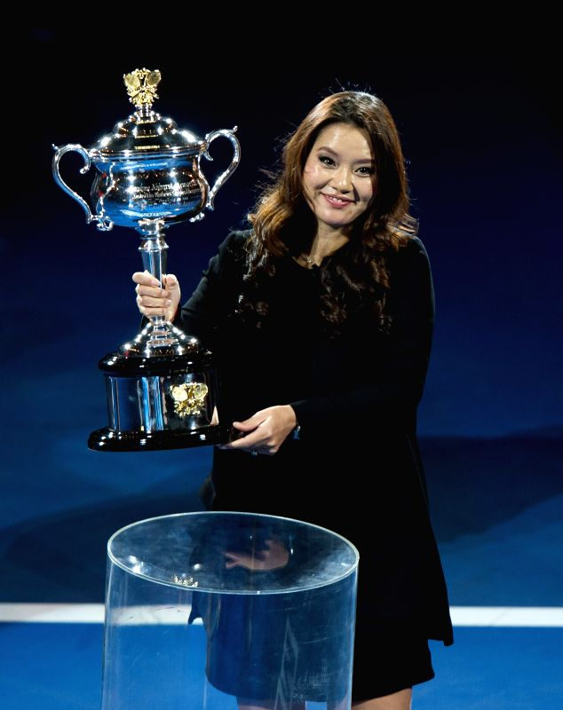 2014 Australian Open tennis champion Li Na of China poses with the trophy during her farewell ceremony at Rod Laver Arena on the first day of 2015 Australian Open