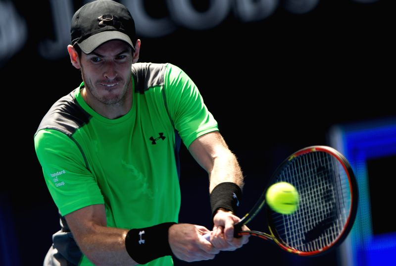 Andy Murray of Great Britain returns a ball during the men's singles first round match against Yuki Bhambri of India at the 2015 Australian Open tennis tournament