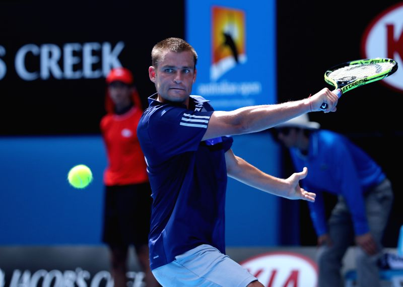 Mikhail Youzhny of Russia competes during the men's singles first round match against Rafael Nadal of Spain at the 2015 Australian Open tennis tournament in ...