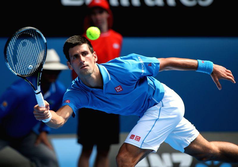 Novak Djokovic of Serbia returns the ball during the first round match of men's singles against Aljaz Bedene of Slovenia at the 2015 Australian Open tennis ...