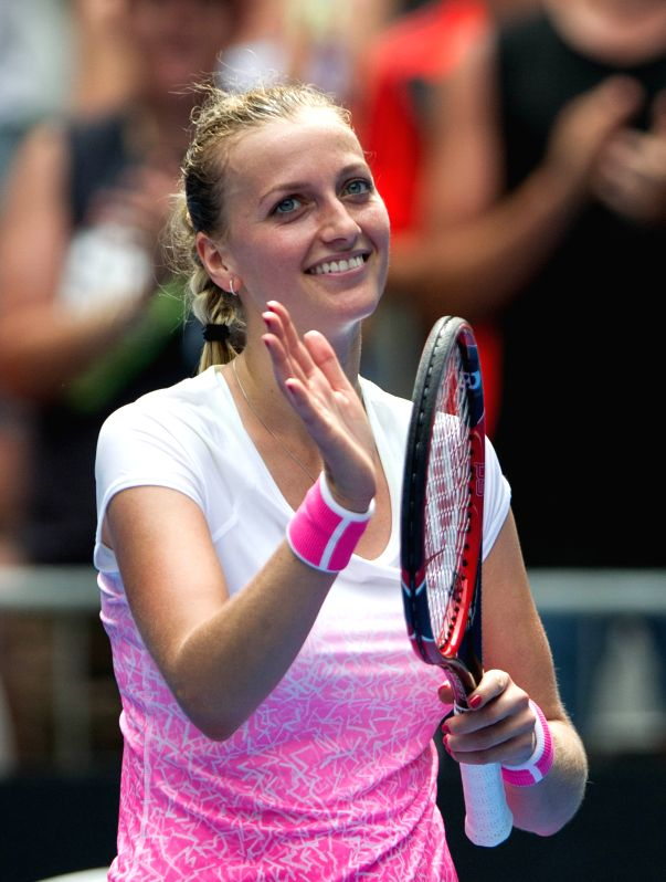 Petra Kvitova of the Czech Republic celebrates after winning her women's singles first round match against Richel Hogenkamp of the Netherlands at the Australian ..