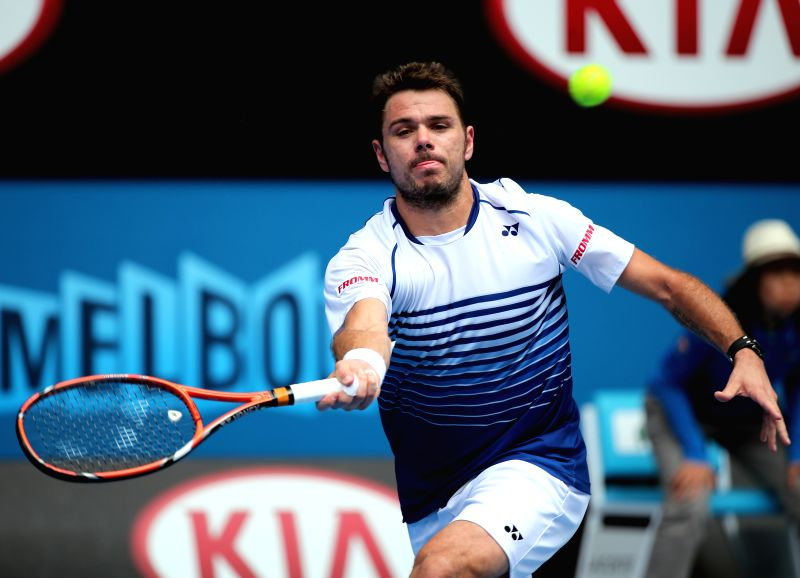 Stan Wawrinka of Switzerland returns the ball during the men's singles first round match against Marsel Ilhan of Turkey at the 2015 Australian Open tennis ...