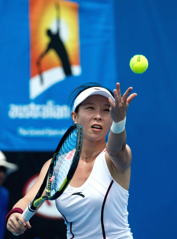 Zheng Jie of China serves during the women's singles first round match against Kai-Chen Chang of Chinese Taipei at the Australian Open tournament in Melbourne, ...