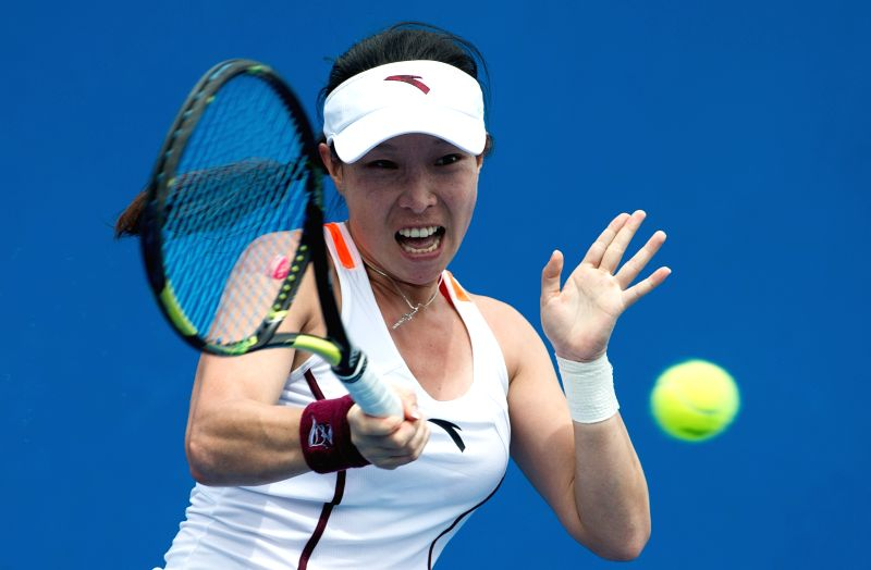 Zheng Jie of China returns the ball during the women's singles first round match against Kai-Chen Chang of Chinese Taipei at the Australian Open tournament in ...
