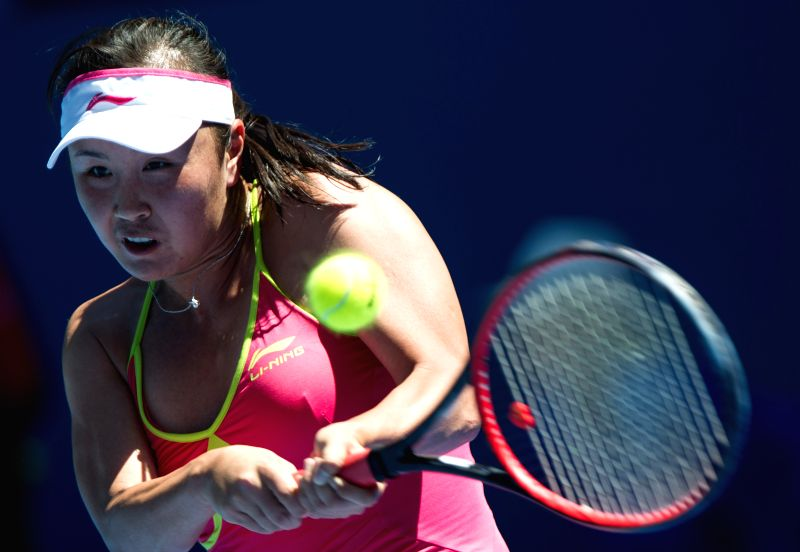 Peng Shuai of China returns the ball during her women's singles second round match against Magdalena Rybarikova of Slovakia at the Australian Open tournament in ..