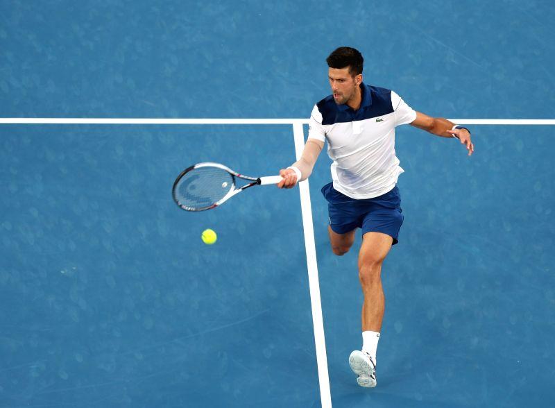 MELBOURNE, Jan. 22, 2018 - Novak Djokovic of Serbia returns a shot during the men's singles fourth round match against Chung Hyeon of South Korea at Australian Open 2018 in Melbourne, Australia, Jan. ...