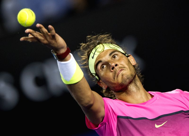 Rafael Nadal of Spain serves the ball during his men's singles third round match against Dudi Sela of Israel on day five of 2015 Australian Open tennis tournament
