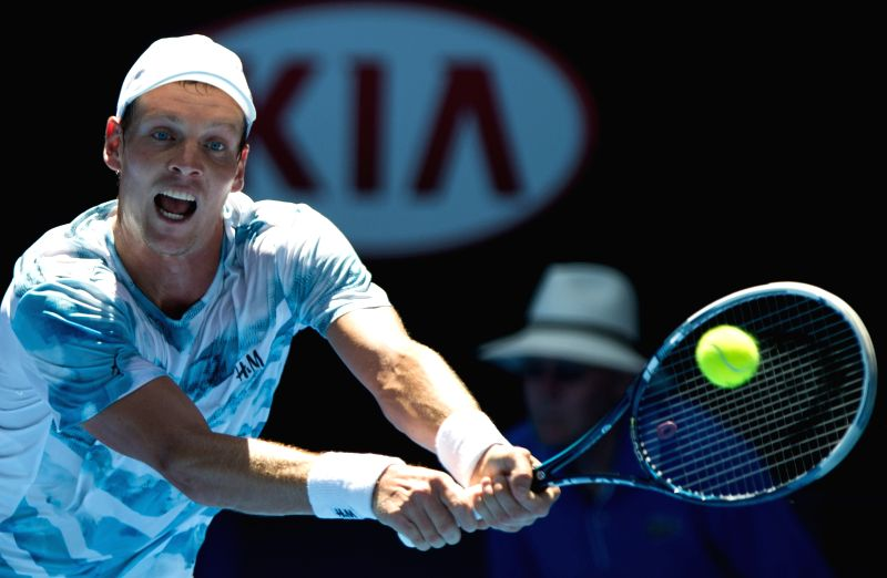 Tomas Berdych of Czech Republic returns the ball during his men's singles third round match against Viktor Troicki of Serbia at the Australian Open tournament in .