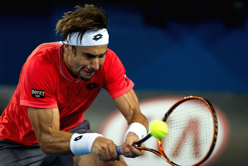 David Ferrer of Spain returns the ball during the men's singles third round match against Gilles Simon of France at the 2015 Australian Open tennis tournament at .