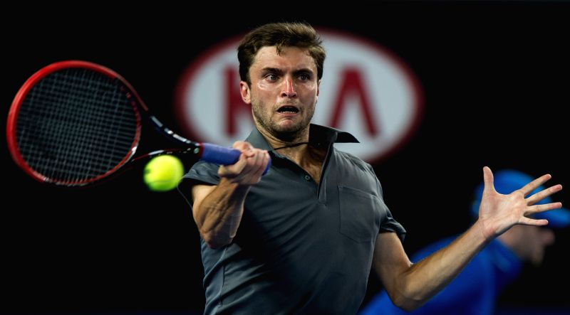 Gilles Simon of France returns the ball during the men's singles third round match against David Ferrer of Spain at the 2015 Australian Open tennis tournament at .