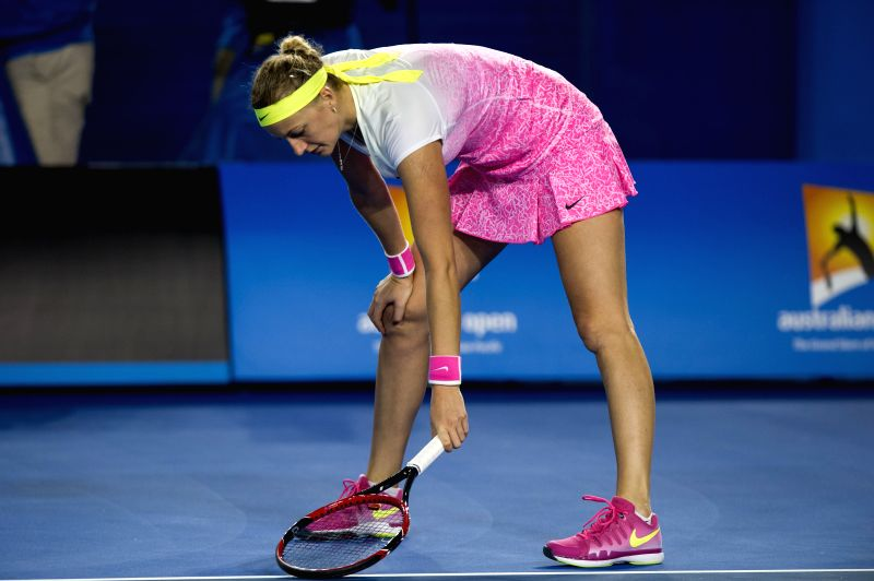 Petra Kvitova of the Czech Republic reacts during the women's singles third round match against Madison Keys of the U.S. at the 2015 Australian Open tennis ...