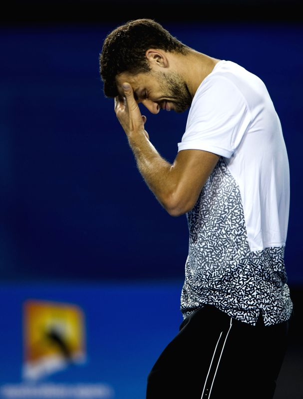 Grigor Dimitrov of Bulgaria reacts during his men's singles fourth round match against Andy Murray of Britain on day seven of 2015 Australian Open tennis ...