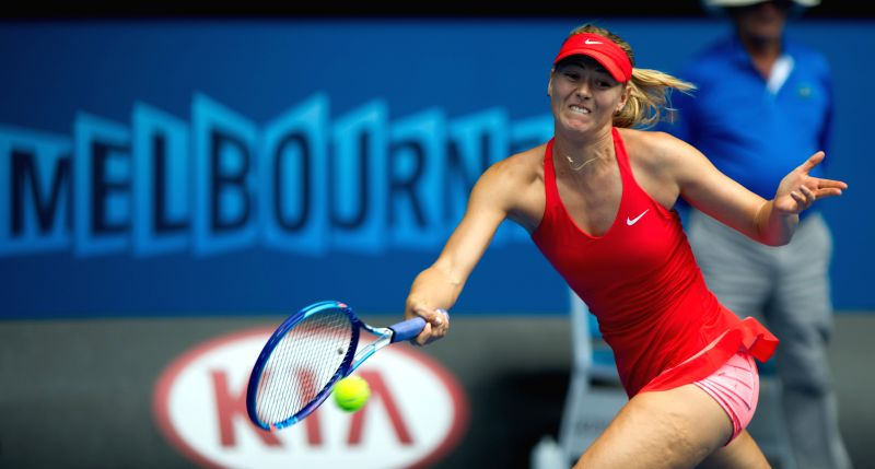 Maria Sharapova of Russia returns the ball during her women's singles fourth round match against Peng Shuai of China at the 2015 Australian Open tennis tournament