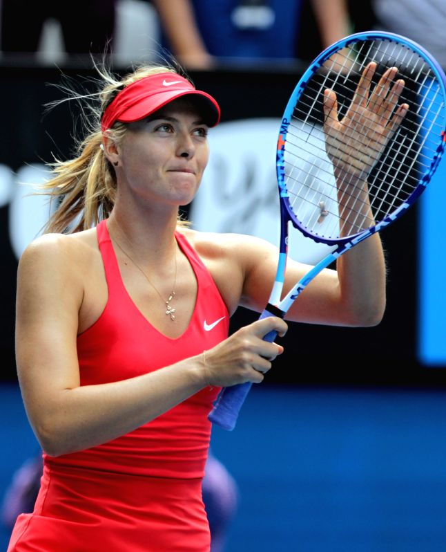 Maria Sharapova of Russia greets the spectators after the women's singles fourth round match against Peng Shuai of China at the Australian Open tournament in ...