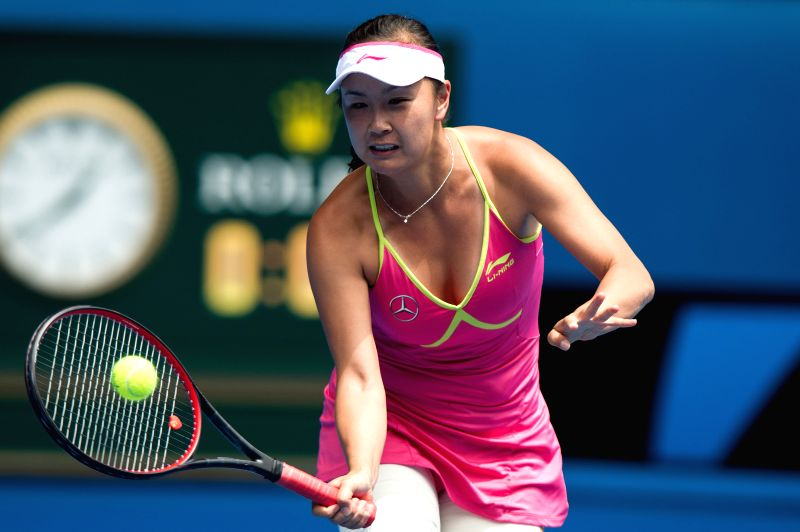 Peng Shuai of China returns the ball during her women's singles fourth round match against Maria Sharapova of Russia at the 2015 Australian Open tennis tournament