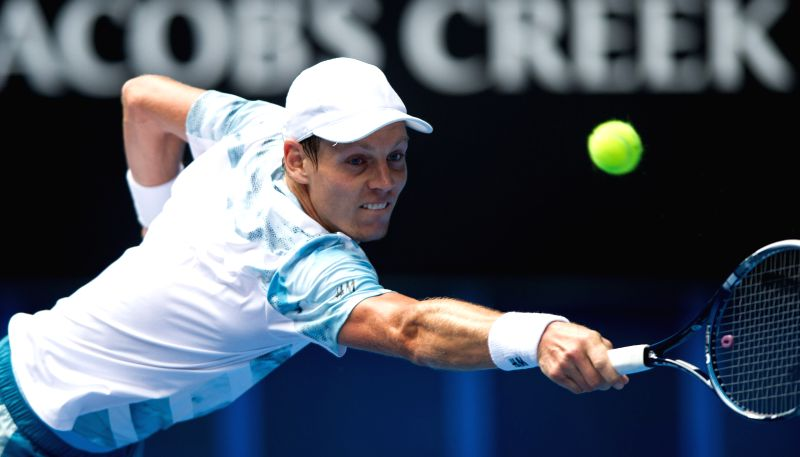 Tomas Berdych of Czech Republic returns the ball during his men's singles fourth round match against Bernard Tomic of Australia at the Australian Open tournament .