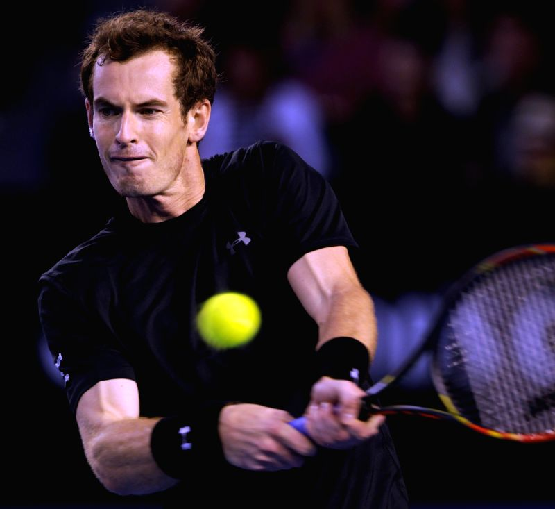 Andy Murray of Great Britain returns the ball during his men's singles quarterfinals match against Nick Kyrgios of Australia on day nine of 2015 Australian Open ..