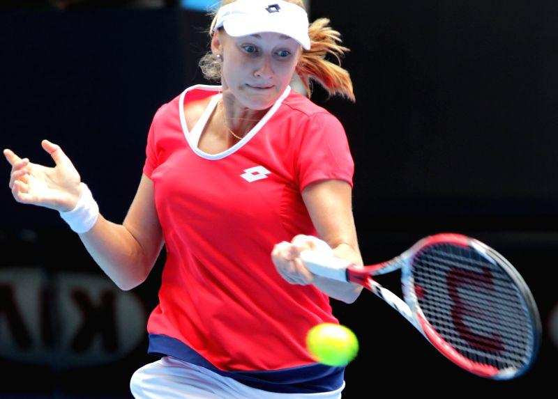 Russia's Ekaterina Makarova returns the ball during the women's quarterfinal match against Romania's Simona Halep at the Australian Open tennis championship in ...
