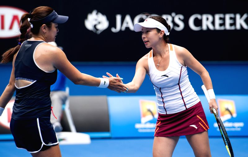 Zheng Jie (R) of China and Yung-Jan Chan of Chinese Taipei react during their women's doubles quarterfinal match against Klaudia Jans-Ignacik of Poland and ...