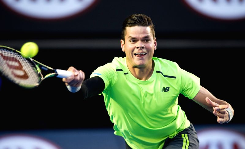 Milos Raonic of Canada returns the ball during the men's singles quarterfinal match against Novak Djokovic of Serbia on the day ten at the 2015 Australian Open ...