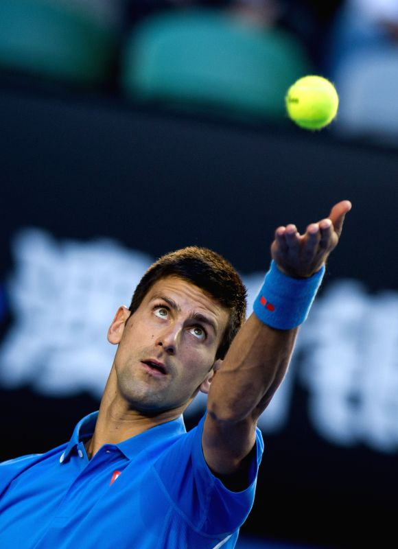 Novak Djokovic of Serbia serves the ball during the men's singles quarterfinal match against Milos Raonic of Canada on the day ten at the 2015 Australian Open ...