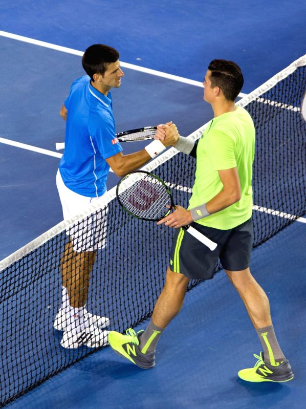 Novak Djokovic of Serbia shakes hands with Milos Raonic of Canada after their men's singles quarterfinals on day ten of 2015 Australian Open tennis tournament at .