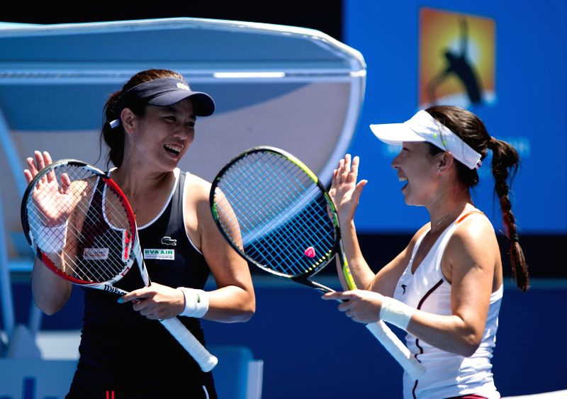 Zheng Jie (R) of China and Chan Yung-Jan of Chinese Taipei celebrate their victory after their women's doubles semifinal match against Michaella Krajicek of the ..