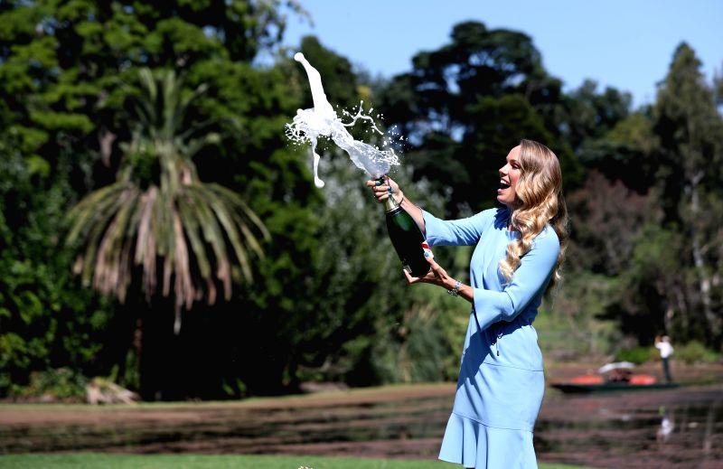 MELBOURNE, Jan. 28, 2018 - Caroline Wozniacki of Denmark sprays champagne during a photo shoot in the Royal Botanical Gardens in Melbourne, Australia, Jan. 28, 2018. Wozniacki defeated Romania's ...