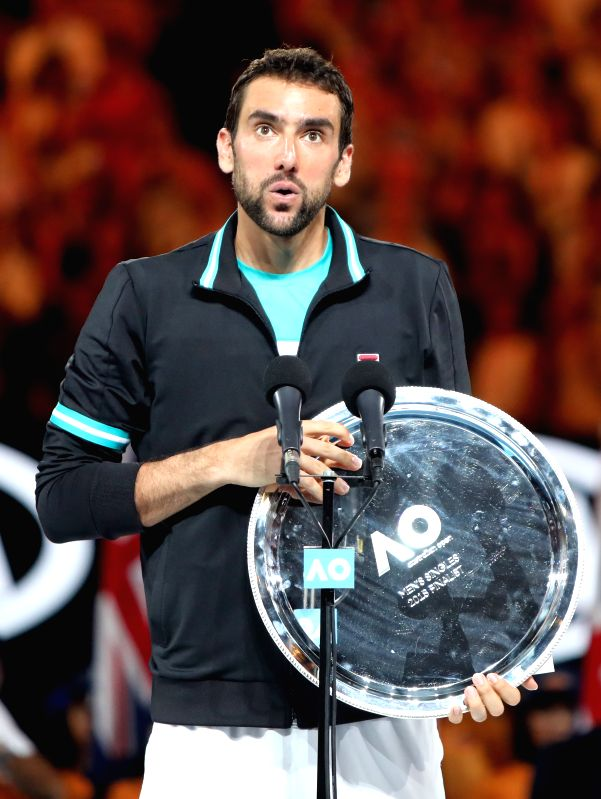 MELBOURNE, Jan. 28, 2018 - Croatia's Marin Cilic gives a speech during the awarding ceremony of the men's singles final match at Australian Open 2018 in Melbourne, Australia, Jan. 28, 2018.