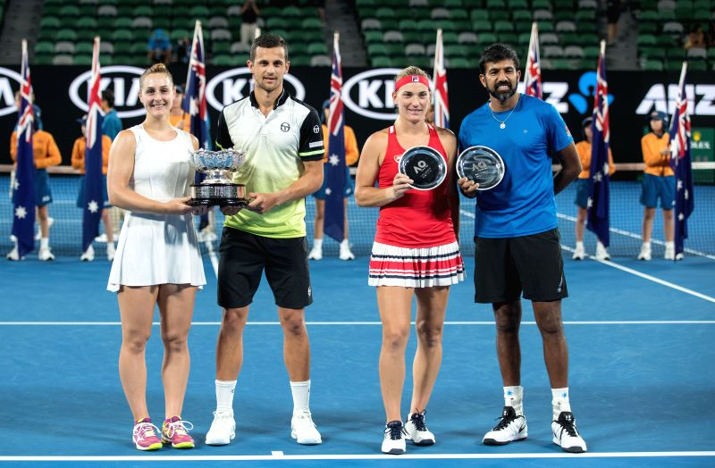 MELBOURNE, Jan. 28, 2018 - (From L to R) Gabriela Dabrowski of Canada, Mate Pavic of Croatia, Timea Babos of Hungary and Rohan Bopanna of India pose for photo during the awarding ceremony for the ... - Rohan Bopanna