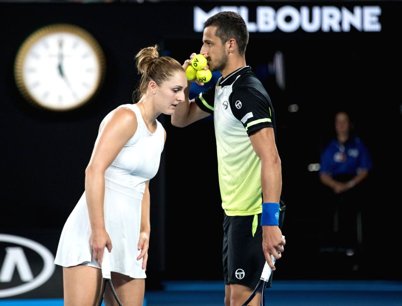 MELBOURNE, Jan. 28, 2018 - Gabriela Dabrowski (L) of Canada and Mate Pavic of Croatia communicate during the mixed doubles final against Timea Babos of Hungary and Rohan Bopanna of India at the ... - Rohan Bopanna