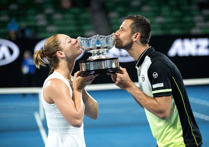 MELBOURNE, Jan. 28, 2018 - Gabriela Dabrowski (L) of Canada and Mate Pavic of Croatia kiss the trophy after winning the mixed doubles final against Timea Babos of Hungary and Rohan Bopanna of India ... - Rohan Bopanna