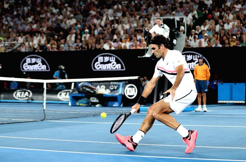MELBOURNE, Jan. 28, 2018 - Switzerland's Roger Federer competes during the men's singles final match against Croatia's Marin Cilic at Australian Open 2018 in Melbourne, Australia, Jan. 28, 2018.