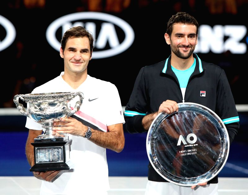 MELBOURNE, Jan. 28, 2018 - Switzerland's Roger Federer(L) and Croatia's Marin Cilic hold their trophies during the awarding ceremony of the men's singles final match at Australian Open 2018 in ...