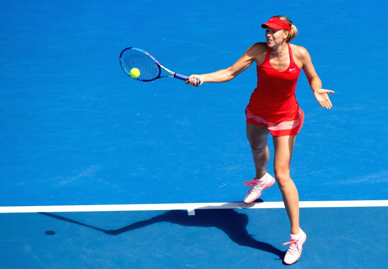 Maria Sharapova of Russia returns the ball during the women's singles semifinal match against her compatriot Ekaterina Makarova at the Australian Open tennis ...
