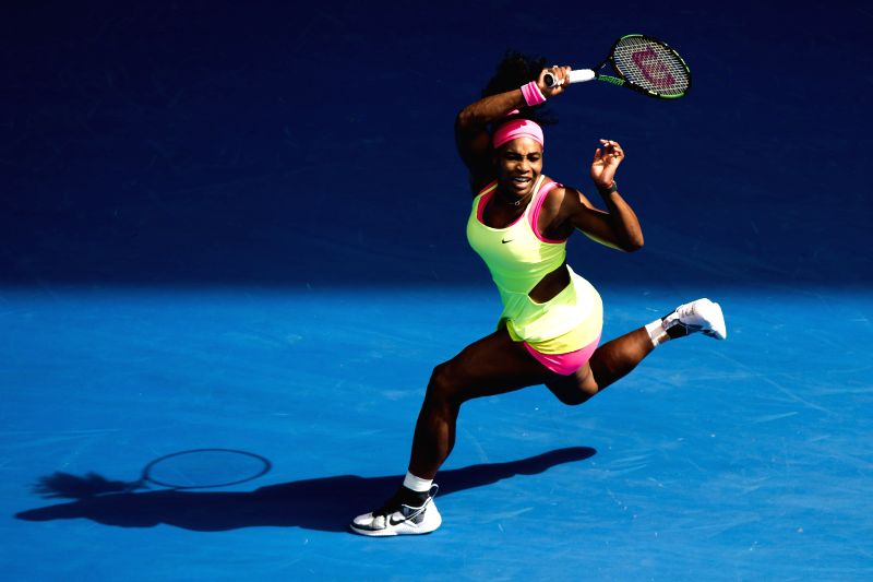 Serena Williams of the U.S. hits a return during her women's singles semifinals match against her compatriot Madison Keys on Australian Open tennis tournament at .