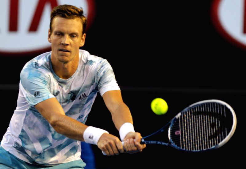 Tomas Berdych of Czech Republic returns the ball during his men's singles semifinal match against Andy Murray of Great Britain at the Australian Open tennis ...
