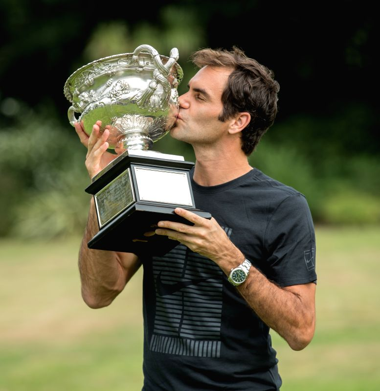 MELBOURNE, Jan. 29, 2018 - Roger Federer of Switzerland kisses his Australian Open trophy, the Norman Brookes Challenge Cup at the Government House in Melbourne, Australia, Jan. 29, 2018.