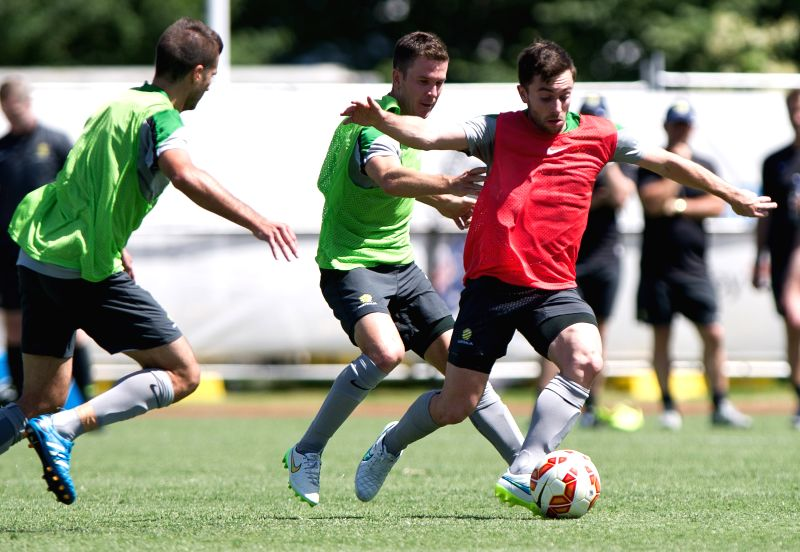 Socceroos player Tommy Oar vies for the ball during the team training session ahead of AFC Asian Cup at the Collingwood Training Centre, Olympic Park in Melbourne,