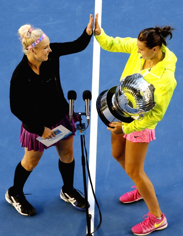 Bethanie Mattek-Sands (L) of the U.S.and Lucie Safarova of the Czech Republic celebrate after winning their women's doubles final against Zheng Jie of China and ..