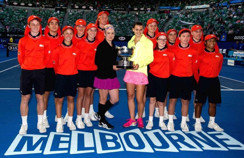 Bethanie Mattek-Sands (USA) (L center)/Lucie Safarova (CZE) pose for a photo shoot with the ballkids as presented with the winner's trophy after their women's ...