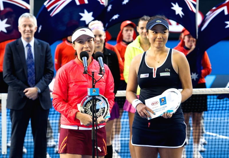 Zheng Jie of China (front left) and Yung-Jan Chan of Chinese Taipei attend the awarding ceremony after their women's doubles final match against Bethanie ...