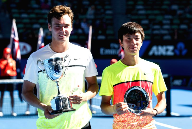 Roman Safiullin (L) of Russia and Seong-chan Hong of South Korea pose with their trophies after winning the Junior Boys' Singles final match at the 2015 ...